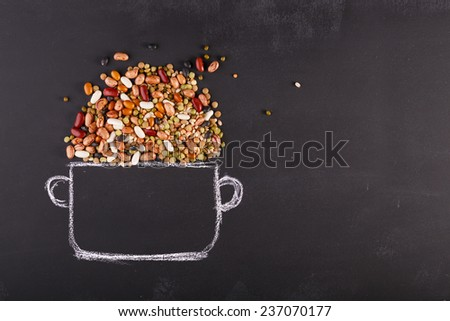 Drawn pot and real pulses on the chalkboard with copy-space Stock photo ©