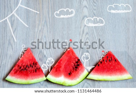 drawn sketchy fellows in the photo of the watermelon are eating  #1131464486