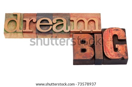 dream big phrase in vintage wood letterpress printing blocks, isolated on white