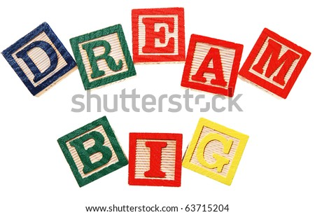dream big - written in colorful wooden blocks, isolated on white