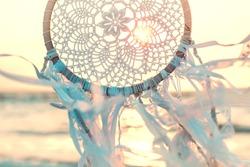 Dream catcher against sunrise. Handmade work is ethnic symbol.