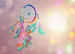Dream catcher and abstract bokeh background