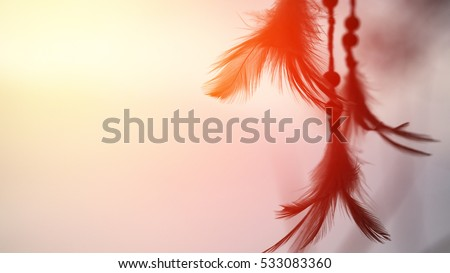 Dream catcher  and the rising sun with blurred focus for  background, #533083360