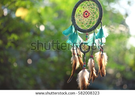 Dream Catcher Blue Coral with natural background in vintage style. boho chic, ethnic amulet. #582008323