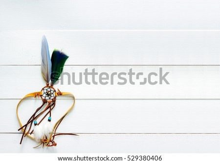 Dream Catcher Handmade Feather on White Wood Background