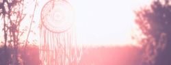 Dream catcher. Horizontal banner.  White and pink colors. Copy space