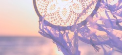 Dream Catcher, in Boho style. Wedding decorations. Harmony with nature. Marine background. Close-up. Banner