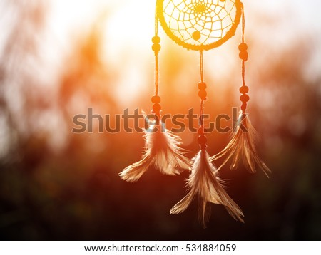 Dream catcher in the wind and blurred bokeh background with selective focus, native american #534884059