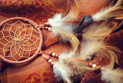 Dream catcher on red canvas