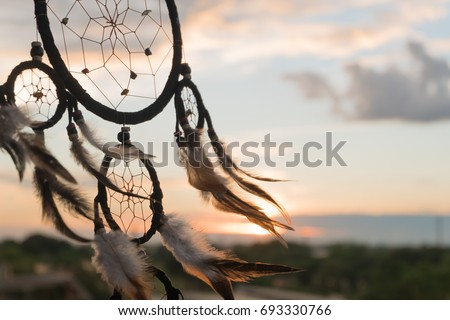 Dream Catcher on the sunset background #693330766