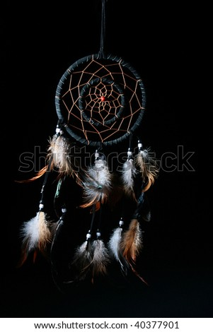 Dream catcheris on a black background, used as a talisman, protection against black forces, can be used in sorcery. - stock photo