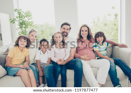 Dream, dreamy, leisure, lifestyle sister brother concept. Portrait of positivity, glad, enjoy, rejoice large family many children rest and relax on sofa in living room look at camera and smile