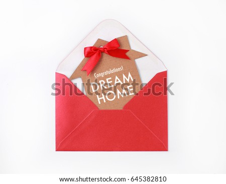 Dream Home Concepts - Cardboard house with red ribbon in an envelop #645382810