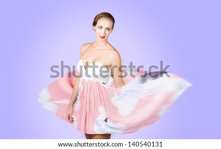 Dream like woman spinning out a dance of elegance, poise and grace. Purple background
