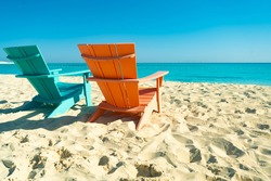Dream paradise beach with 2 chairs at the turquoise Mediterranean sea at El Alamein near Alexandria, Egypt