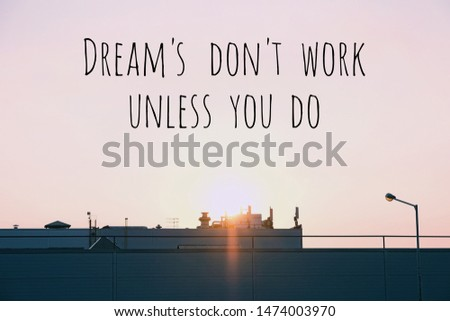 Dream's don't work unless you do. Inspiration motivation quote about happy life. sunset or sunrise, sky and industrial buildings. industrial landscape.