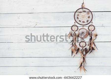 Dreamcatcher, american native amulet on wooden background. Shaman