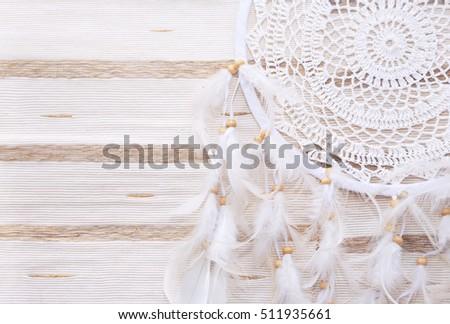 Dreamcatcher on a beige background #511935661