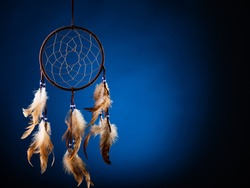 Dreamcatcher on a blue background, with space for an inscription. Cultural amulet