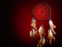 Dreamcatcher on a red background, with space for an inscription. Cultural Amulet, Indian Culture