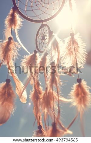 Dreamcatcher sunset, boho chic, ethnic amulet, symbol. toned image #493794565