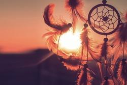 Dreamcatcher sunset , the mountains. Boho chic, ethnic amulet,symbol