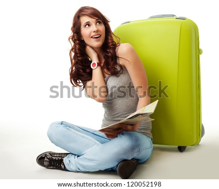 Dreaming about going on vacation - woman witting with big green bag, isolated on white