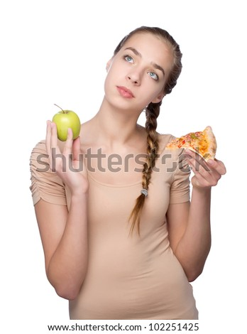dreaming beautiful young woman with pizza and apple