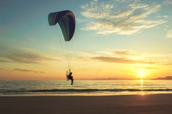 Dreaming the Icarus with motor paragliding at sunset beach in South Korea