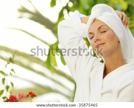 Dreaming young woman after bath