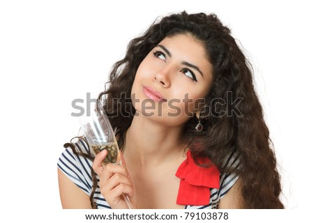 Dreaming young woman with champagne looking up and sidewards