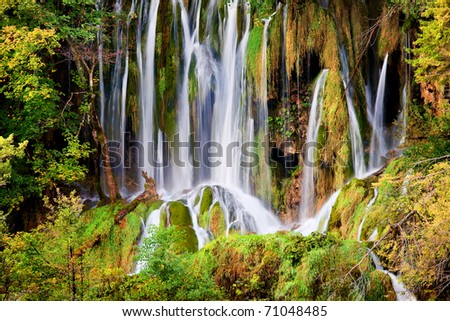 Dreamlike waterfall in a beautiful autumn scenery of Plitvice Lakes National Park in Croatia