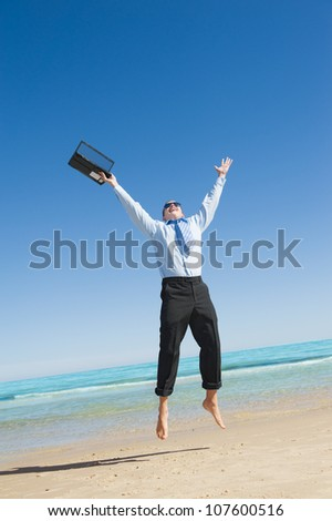 Dreams come true. First day of vacation.Businessman  on the beach