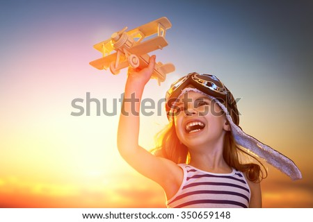 dreams of flight! child playing with toy airplane against the sky at sunset #350659148