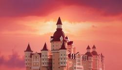 Dreamy castle on a background of fairy sunset sky.