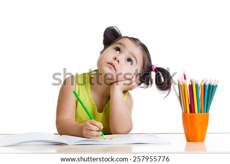 dreamy child girl with pencils isolated on white