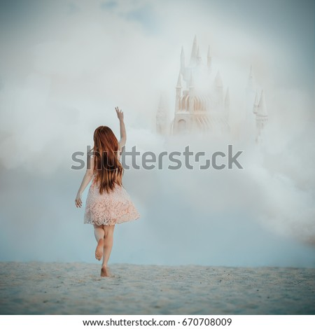 Dreamy fine art picture of a girl chasing a castle in the sky. Imagination concept