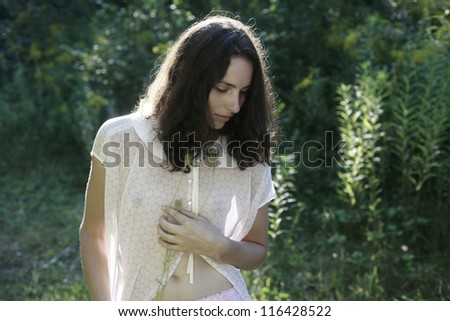 Dreamy girl in the green nature