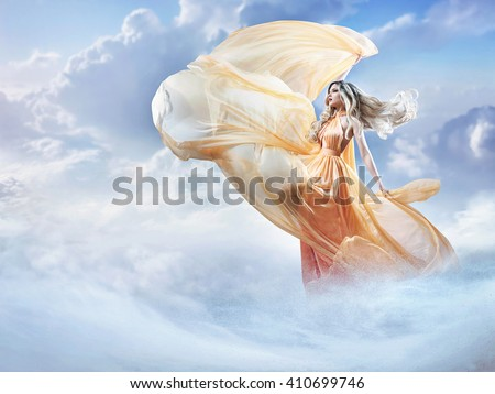 Photo of Dreamy image of a beautiful young lady in the clouds