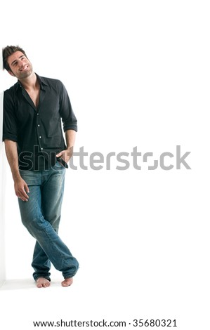 Dreamy latin man looking up with copy space for your text isolated on white background