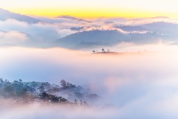 Dreamy mountain landscape at beautiful misty sunrise morning