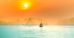 Dreamy sunset among the rocks of Halong Bay, Vietnam, This is the UNESCO World Heritage Site, it is a beautiful natural wonder in northern Vietnam