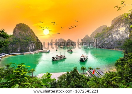 Dreamy sunset landscape Halong Bay, Vietnam view from adove. This is the UNESCO World Heritage Site, a beautiful natural wonder in northern Vietnam