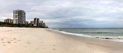 Dreary Grey sky over the beach of Park Shore Beach in Naples, Florida
