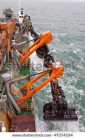 Dredging at sea - stock photo
