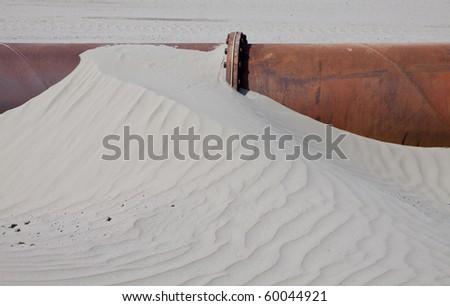Dredging pipe - stock photo