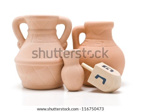 Dreidel and the small oil jug that last for eight days.