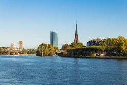 Dreikönigskirche, European Central Bank (EZB / ECB) and Eiserner Steg seen from the banks of the river main in Frankfurt (Frankfurt, Germany, Europe)