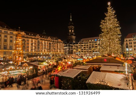 DRESDEN, GERMANY - DECEMBER 7: A group of people enjoy Christmas market in Dresden on December 7, 2012. It is Germany's oldest Christmas Market with a very long history dating back to 1434.