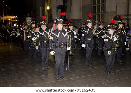 DRESDEN, GERMANY - DECEMBER 17: Dresden philharmonic orchestra doing a music parade walking in the historic center of Dresden during the time of Traditional Christmas markets in Dresden,Germany,2011.dec17